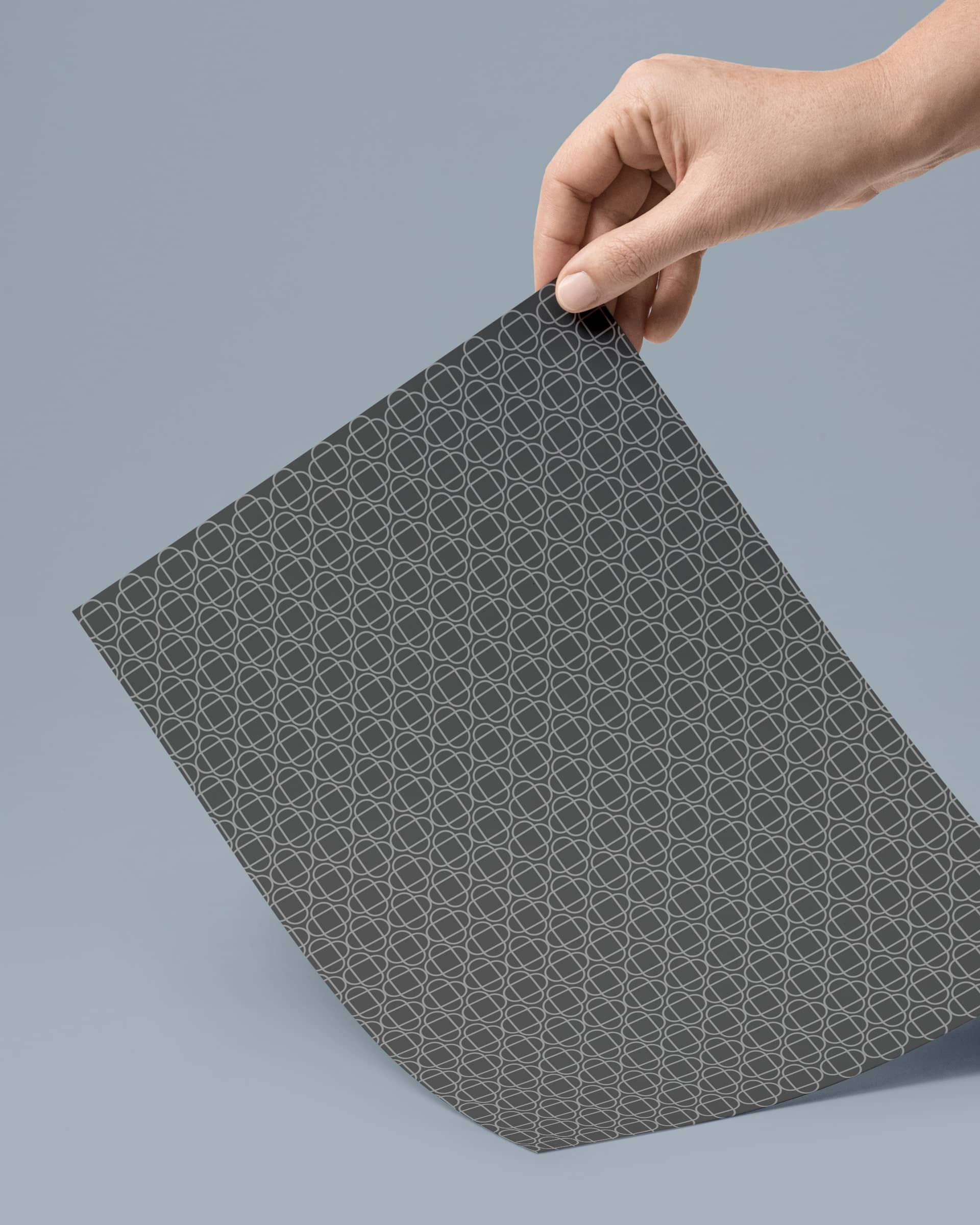 Dark grey geometrical pattern design printed on paper